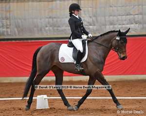"Lauren Cocks rode ""Miss Skiing"" placing 3rd in the Novice reestyle with a score of 67.084%"