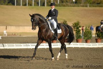 Jody Hartstone from New Zealand with her 19 year-old New Zealand Grand Prix Champion, the stallion, 'Landioso' by Landgraf. They took third place in the Koffels Solicitors and Barristers Intermediate II with 64.68%.