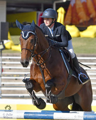 Shelley Simmons and 'Corinda' are pictured during the Group C jump off class this morning.
