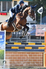 Kirsty Ansell is pictured aboard her, 'Tulara Stolensky' on their way to posting a first round clear in the Group C jump off class.