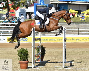Samantha Dernee and 'Lady Gaga G' from Tamworth in NSW make a lovely jump on their way to third place in the Young Rider class this morning.