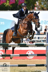 Chris Holland from Maroochydore in Queensland is pictured making a lovely jump on their way to second place in the Young Rider class this morning.