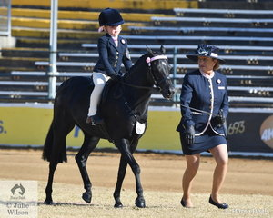 Well know and successful Queensland exhibitor, Elva Christensen is pictured shepherding Emmerson Wagner in to second place in the class for Rider 5 Au 6 years.