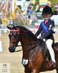 Following a long family tradition, Piper Thompson won the class for Girl Rider 8 AU 10 Years.