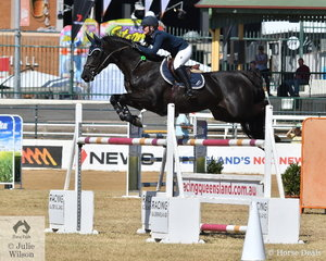 Successful young showjumping rider, Brooke Langbecker was aboard her stallion, 'Black Jack IXE' and took third place in the Group B Championships today.