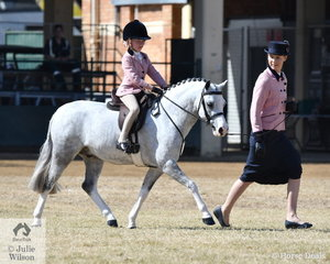 The beautifully matched combination of Katrina Christensen, rider Abby Smith and Kristi Gartner's, 'Llangollen Porsche' won the class for Leading Rein Show Hunter Pony N.E. 12hh.
