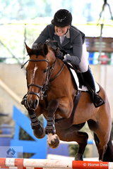 Melissa Blair shows the determination that she displayed riding Gigant Z to a popular win in the Sutton Ouverture Sport Horses Future Stars Art. 273.3.3.1.