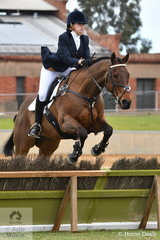 Emily Hill representing Ebondale Park is pictured aboard, 'Gun Dolphin' during the class for Lady's Hunter.