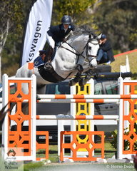 Gabi Kuna is pictured aboard the talented stallion, 'Cera Cassiago' on her way to third place in the Lennock Motors Grand Prix Warm Up class.