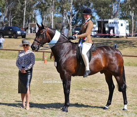 """Judge Michelle White with her Champion Child's Large Show Hunter Hack """"Kryptonyte"""", ridden by Zali Peterson."""