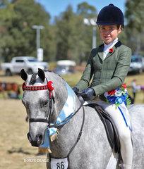 """Champion Child's Large Open Pony """"Mirinda Lancelot"""" and Isabel Duke-Daly."""