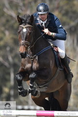 Victorian veterinarian, Adam Johnson was unlucky to post just one time penalty in the first round of the Fielder's Roofing Mini Prix  riding his home bred 'Up'.