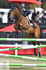 Teenager, Jessie Rice-Ward had a wonderful show and is pictured during the Fielder's Roofing Mini Prix jump off today.