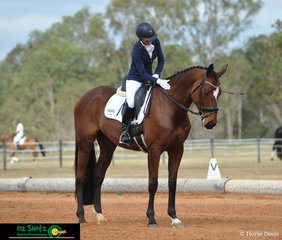 Thanking Estrellas Remarkablez after the completion of a great test in the AAOR Preliminary 1B is Terri Kolb, riding on day 1 of the QLD State Dressage Championships.