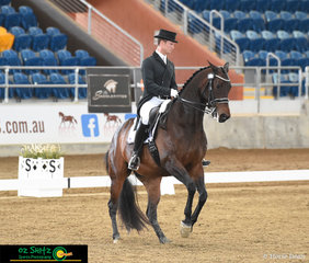 Executing a great canter pirouette in the Open Prix St George class is Laquestar ridden by Elliot Patterson at the 2019 QLD State Dressage Championships.