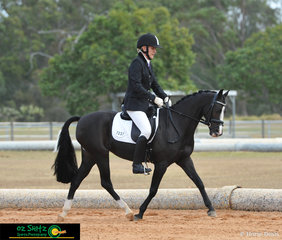 Competing in the Pony Preliminary class on day 1 of the 2019 QLD State Dressage Championships is Karen Prain riding Karanga Myriah.