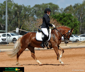 Showing everyone how it's done in the Pony Preliminary 1B test is Hannah Barker and Grenwood Roseanna.