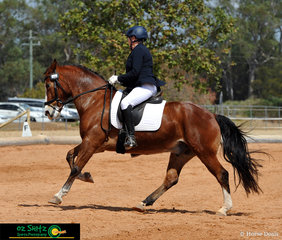 Completing a great test in the Pony Preliminary 1B test on day 1 of the QLD State Equestrian Centre is Karen Howard riding Indi Molloy.