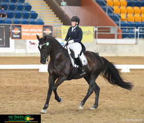 Competing in the AAOR Intermediate A class at the QLD State Dressage Championships and executing a lovely test is Nichole Aird riding Larundel Gianni.