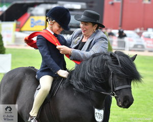Jumping rider, Coach and now Junior Turnout judge, Cindy Morrison is pictured sashing  Lilly Gin aboard Annabelle Richardson  's 'Oak Park Paramount' for second place in the class for Shetland Pony Turnout In Saddle, Riders 8-10 Years.