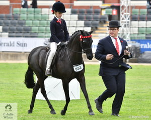 The winning combination of Jeremy Roberts and Ivy Aikman along with Joanne Deane's, 'Langtree Unique' won the class for Leading Rein Pony 12hh and Under.