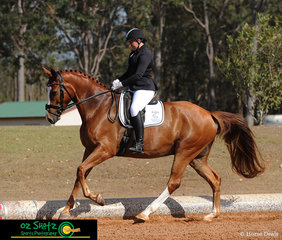 Cantering confidently in the Open Elementary 3B test on the third day of the QLD State Dressage Championships is Erin Flanagan and Benchmark Live The Dream.