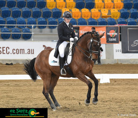 Executing an outstanding canter pirouette in the Open Intermediate I class at the QLD State Dressage Championships is San Rhythmic with Elloise Devlin in the saddle.
