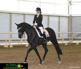 Competing in the Open Advanced class on the third and final day of the QLD State Dressage Championships is Nicole Tough and Ferragamo.