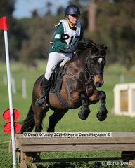 """Winner of the Grade 4 Section 1 Chloe Windt from Cranbourne Pony Club riding """"Jack Daniels Whisky"""""""