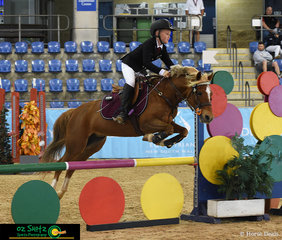 From QLD is Finnigan Bazzan and Bundaleer Harmony in the 80cm AM5 show jumping at Interschool Nationals held at the Sydney International Equestrian Centre..