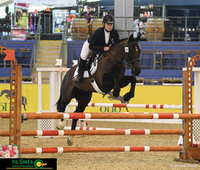 Jumping his way to victory and all the way from Tasmania is Emily Irvine on her horse Rosebank Stella in the Secondary 90cm 2 Phase Show Jumping class at the 2019 Australian Interschool Nationals.