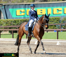 Trotting up the centreline in their Secondary Advanced Dressage test is Kelsey Josephs and Irock, riding on the final day of Interschool Nationals. ..