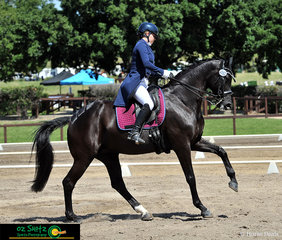 Completing a beautiful flying lead change in the Secondary Intermediate I class is Riverview Cinderella and Felicity Shearer, riding for Queensland.