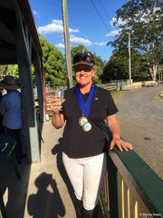 Paula Anthony  Gold in the Novice and the Elementary  celebrating her wins with a glass of bubbles