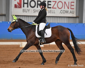 "Mickayla Prindable from Victoria rode ""Wild Child"" in the Novice Canter Open & Advanced placing 2nd with a score of 64.231%"