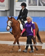 "Elizabeth Maver from Victoria rode ""Zack"" in the Walk Led placing 4th with a score of 62.667%"
