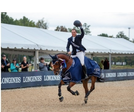 The American rider and his longtime mount Carlchen W dominate a 12-horse jump-off. Credit: FEI