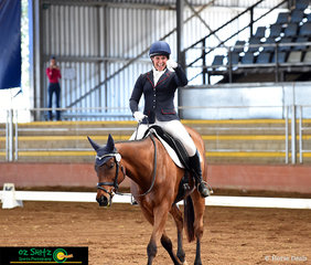 Excited after performing a successful dressage test in the One Star was Jodie Smith riding Jeds Jetset Lad.