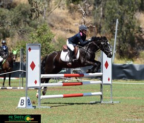 The small but mighty Wynnstay Hunter clears the second element of the combination in the EvA95 Show Jumping with Georgia Wheatley on board. .