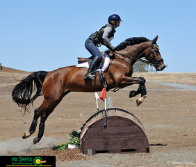 APH Alpine shows great form over the water rolltop in the EvA95 Cross Country with rider Tanya Schmidt.