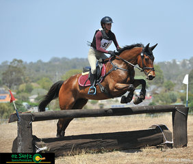 Say You Didn't Do It enjoys being out on the Cross Country course with rider Steffani Melville as they navigate through Farmyard in the EvA95cm at Toowoomba ODE. .