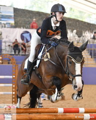 Tori Glass representing Victoria rode Bonnie Valley Nobuck Boris to second place in the Junior Showjumping Event 1.