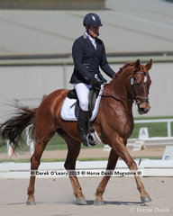 """Paul Chow rode """"Flores"""" in the Elemntary 3A placing 5th with a score of 59.028%"""