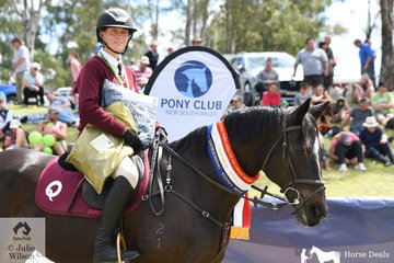Chelsea Jefferies from Qld rode All Bling to take out the Junior Showjumping equal Championship.