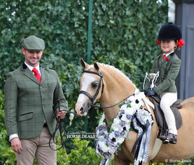 """Cameron Wood led Maia Warren's """"Imperial Bow Tie"""" to win Champion Show Hunter Leading Rein Pony, ridden by Molly Manchester."""