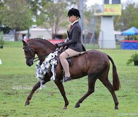 "Tanya Benton-Hall rode the  Benton & Benton-Hall Families entry ""Owendale Valencia"" to win Champion Small Show Hunter Pony of the Year."