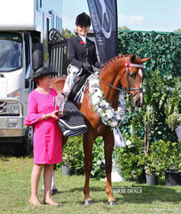 """Judge Geraldine Crocker with the Champion Large Show Hack """"Seventy Seven"""" exhibited by the Crawford Twins, ridden by Trinette Craeford."""