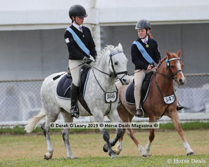 """Molly Spry and """"Junior"""", and Macy Cooper and """"Kingsfred Destiny"""" work out in the Pony Club Pairs"""