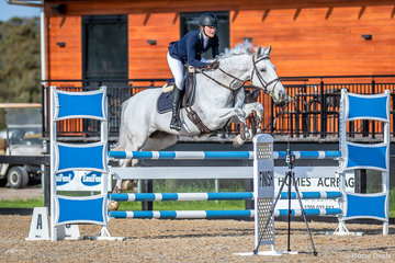 Rebecca Rogers and Jasper Park Vienna jumping for joy as part of a 66 rider strong field in event 2a Open 110cm atone Park.