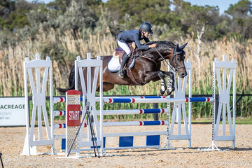 Courtney Shears with Kookai showing great form in event 2a 110cm Div A in the sunshine on Friday before the rain fell on Saturday at Boneo Park.